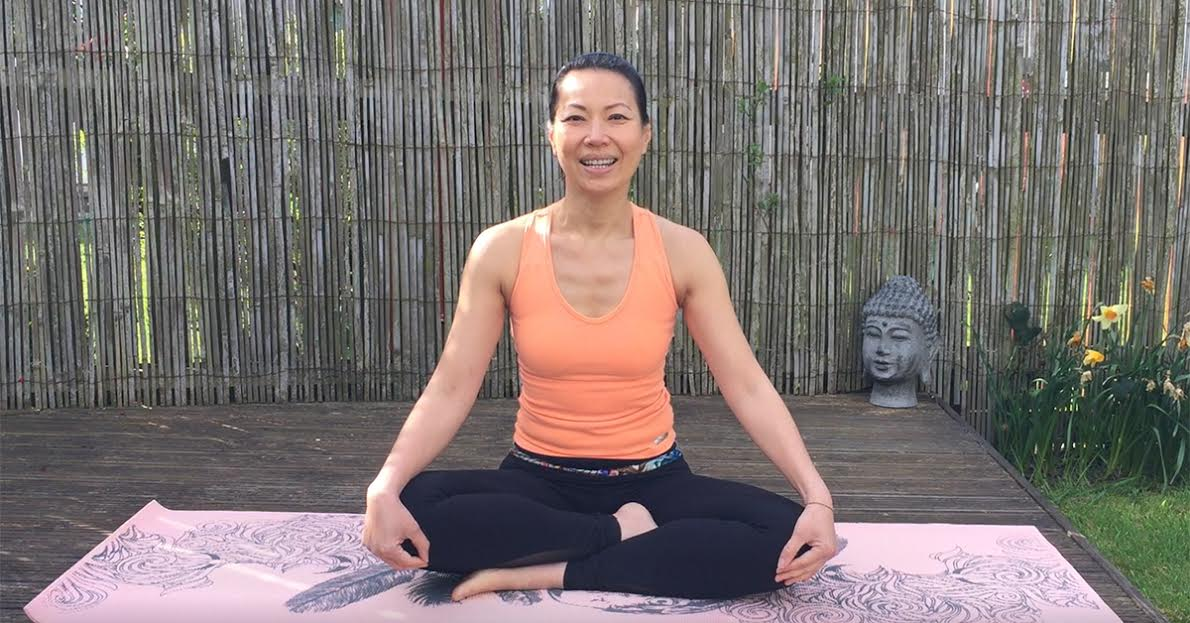 Woman demonstrating yoga to promote mindfulness